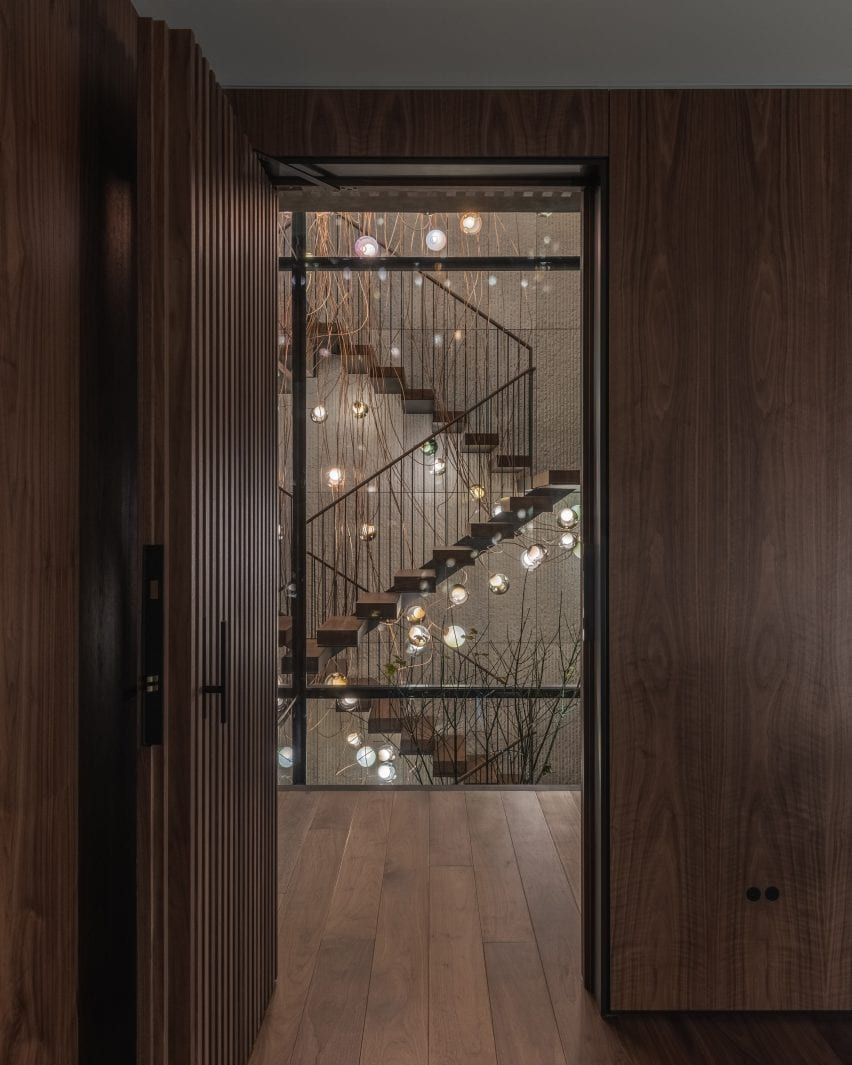 A lighting installation floats in the stairwell