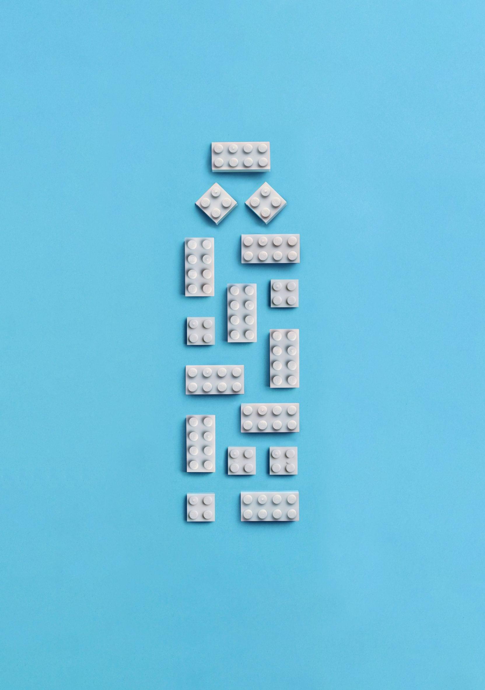 White lego bricks arranged in the shape of a bottle