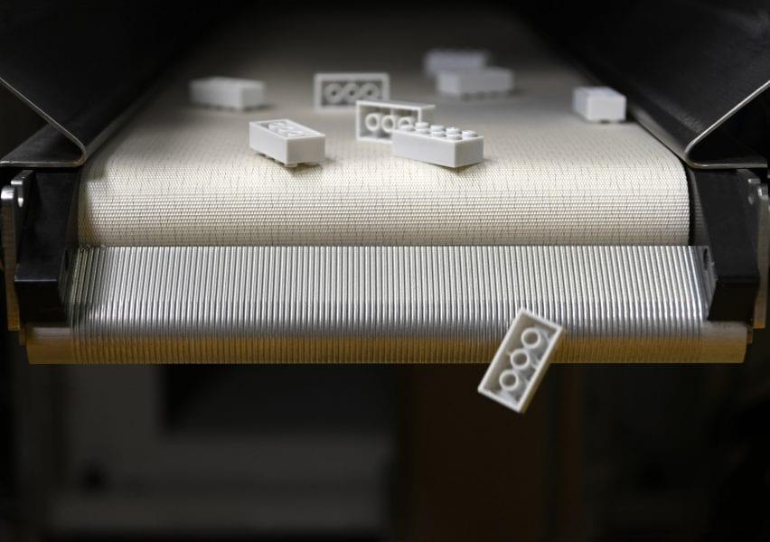 White Lego bricks on a conveyer belt