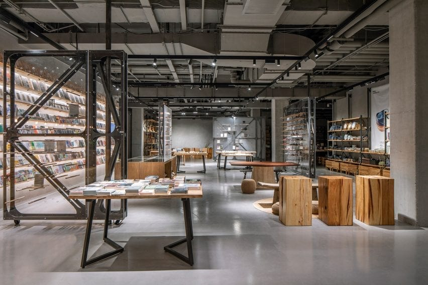 Bookstore with wooden display stands and clear dividers by LUO Studio