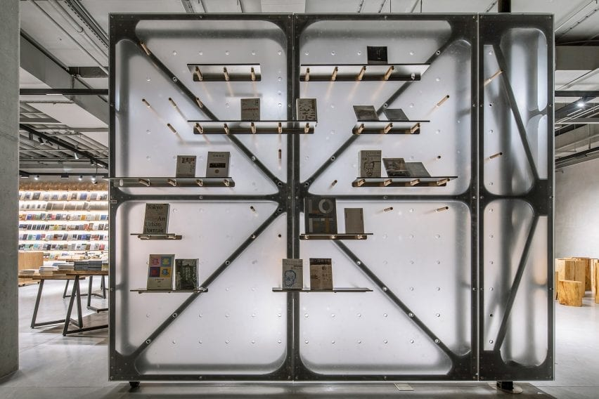 Transluscent room divider with book storage in retail interior by LUO Studio