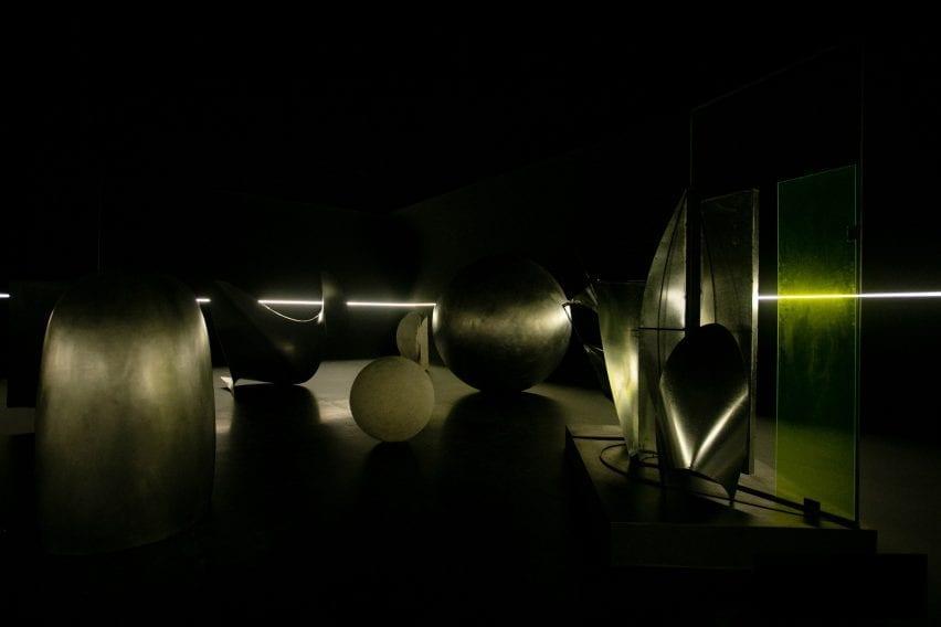 Gleaming metal art in a dark room
