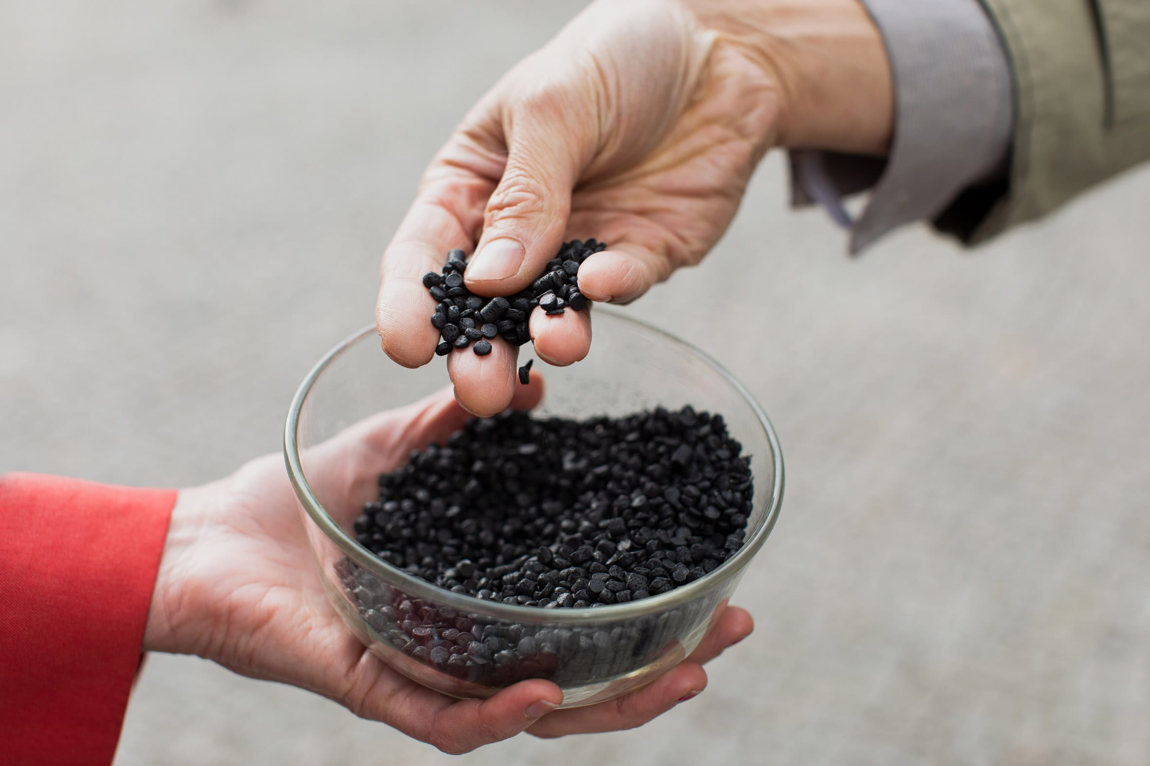 Granules of black biochar plastic