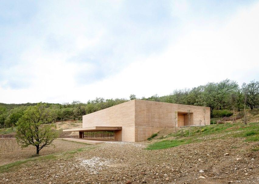Monolithic ochre-coloured building