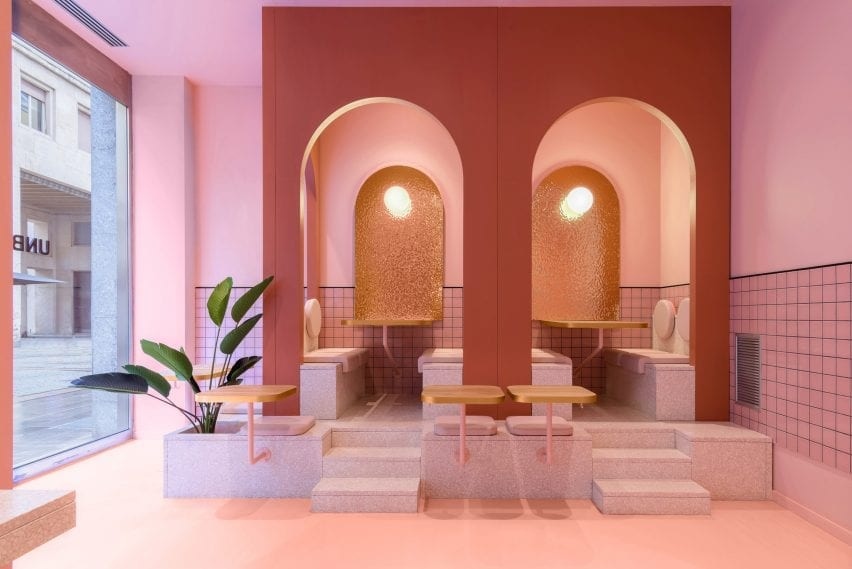 The planter is located in a pink seating area