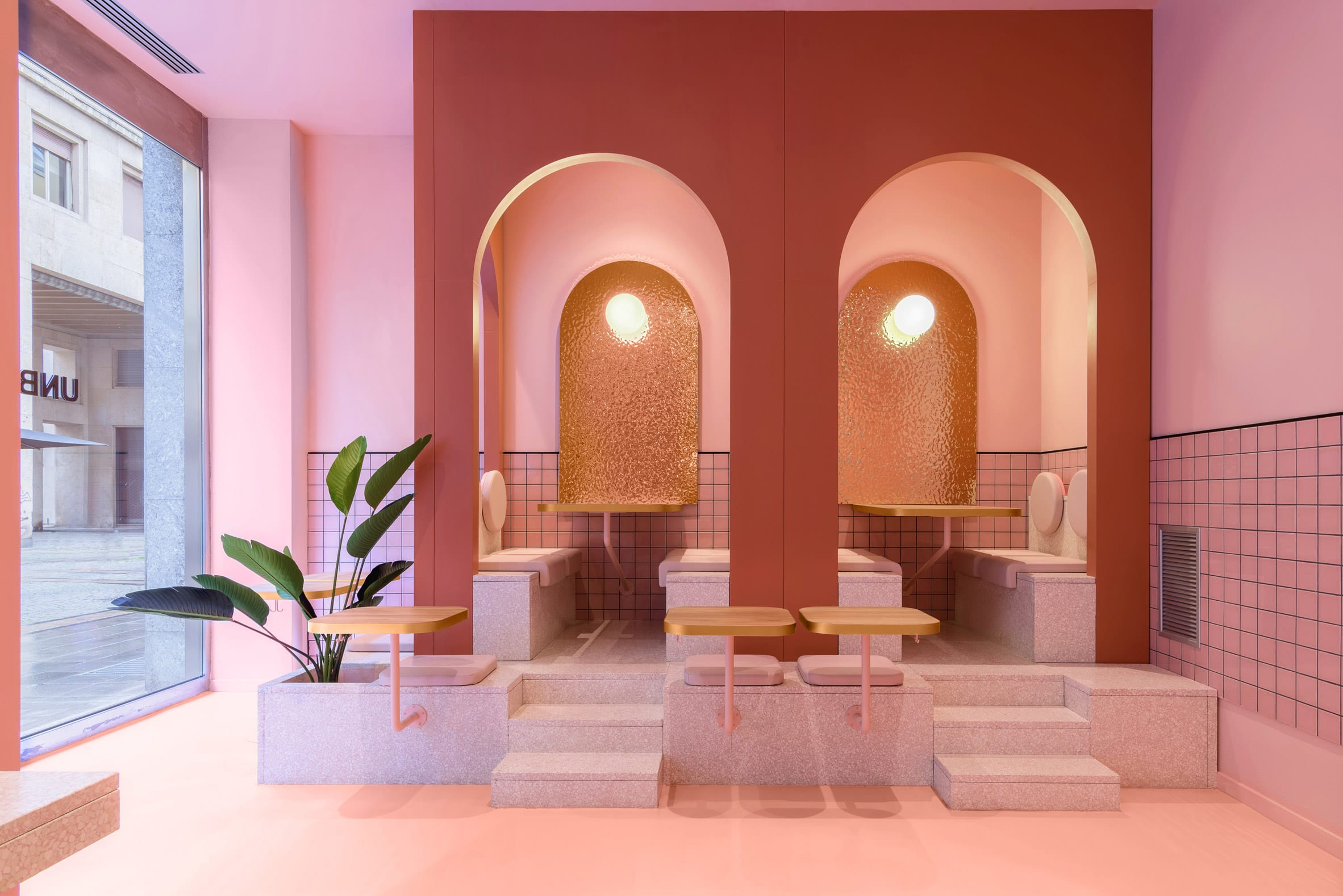 A planter features in the pink seating area
