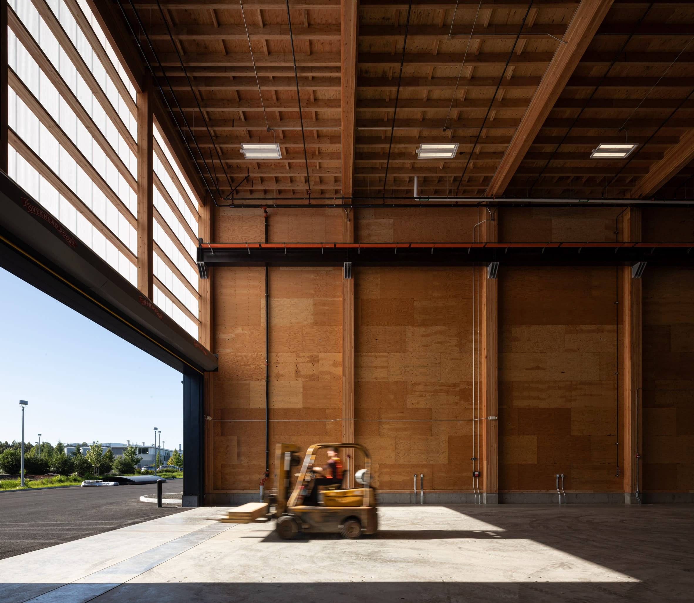 Inside, the building has expansive areas for developing and testing wood products