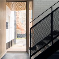 A mesh staircase leads to the upper level