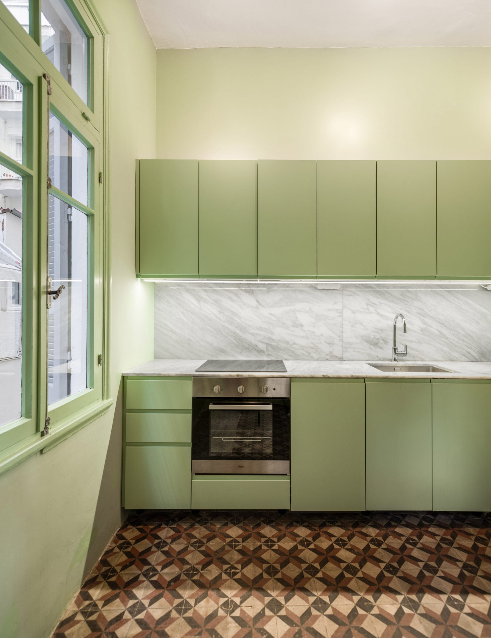 Giannikis used pastel greens in the one-wall kitchen