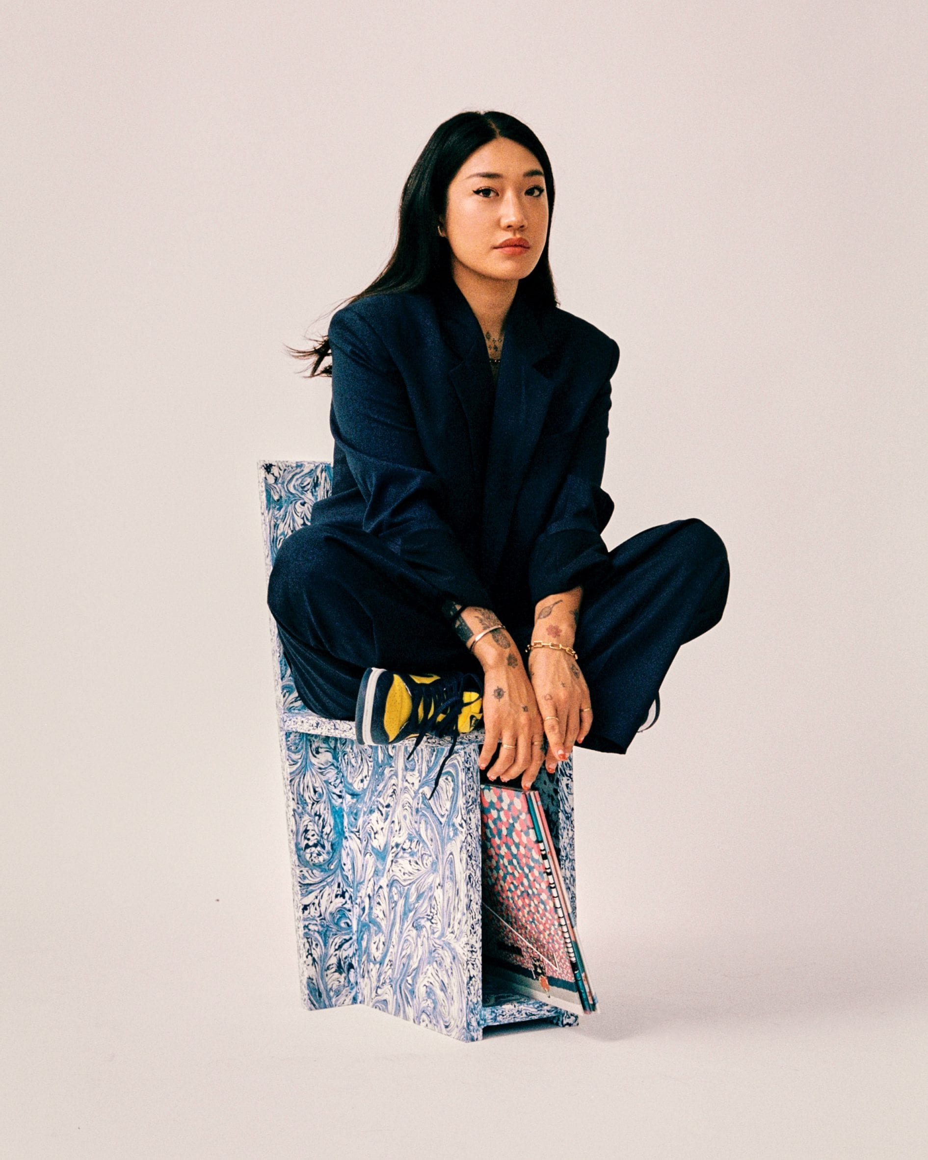 Peggy Gou on chair with vinyl storage designed with Space Available