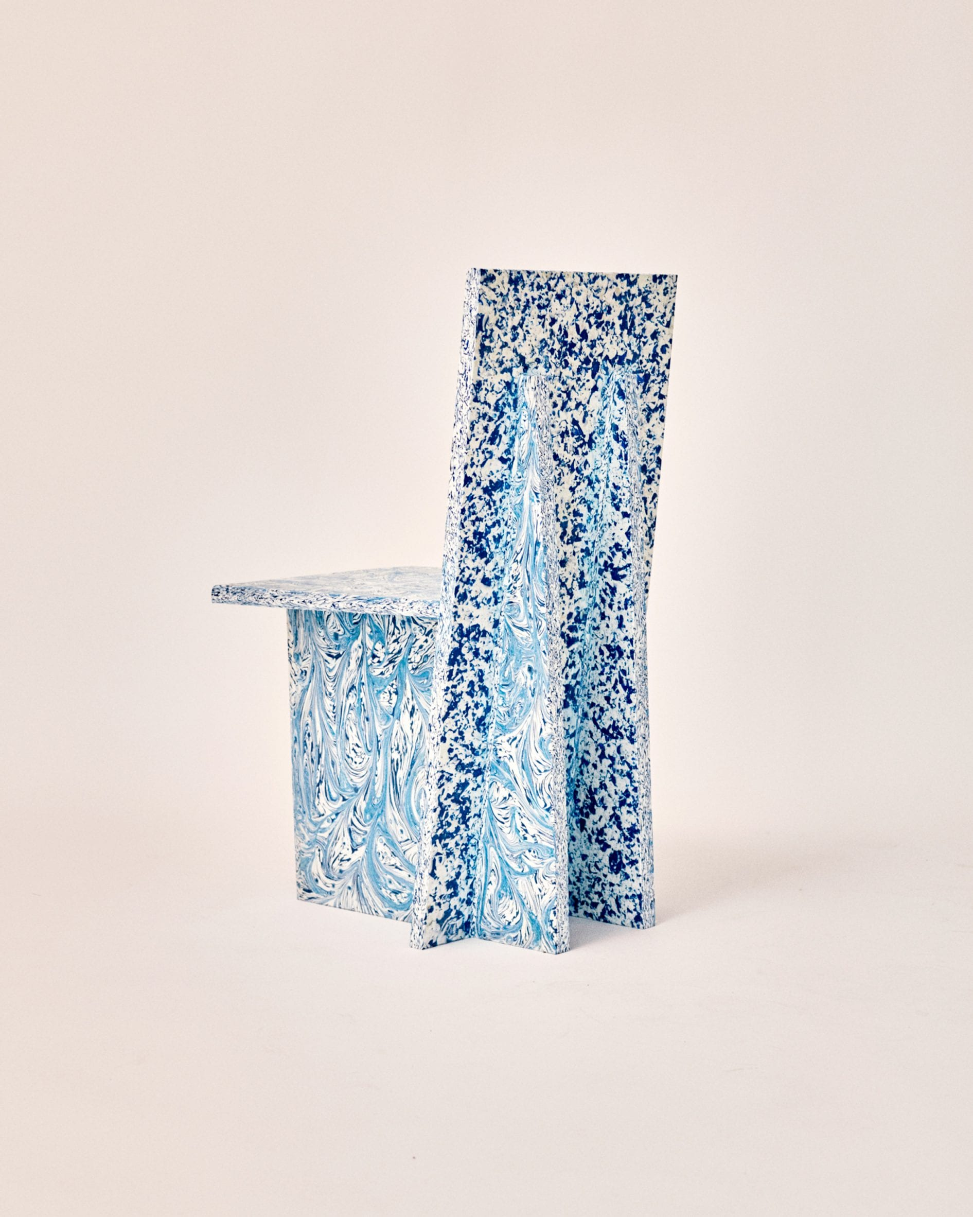 Back blue and white chair with speckled pattern by Peggy Gou and Space Available