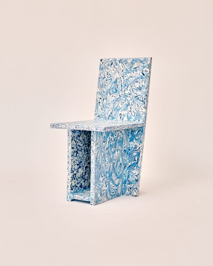 Side view of speckled blue plastic chair by Peggy Gou and Space Available