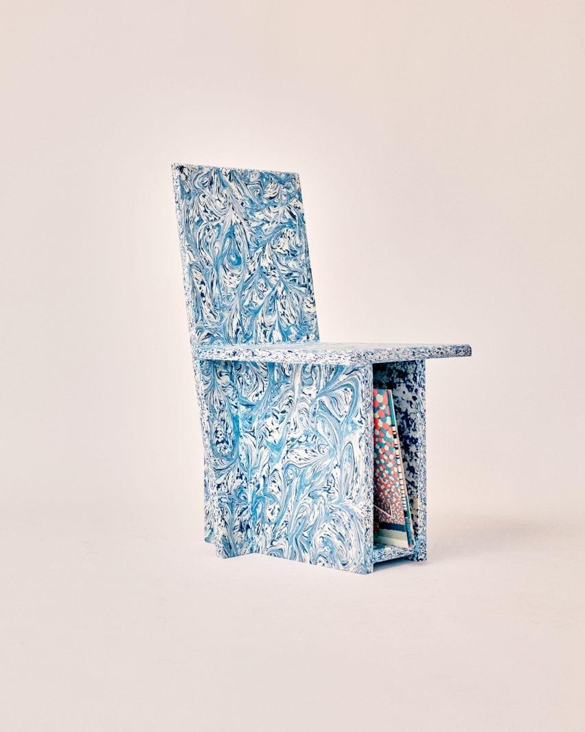 Trash to Chair made from recycled plastic with swirly blue pattern and vinyl storage
