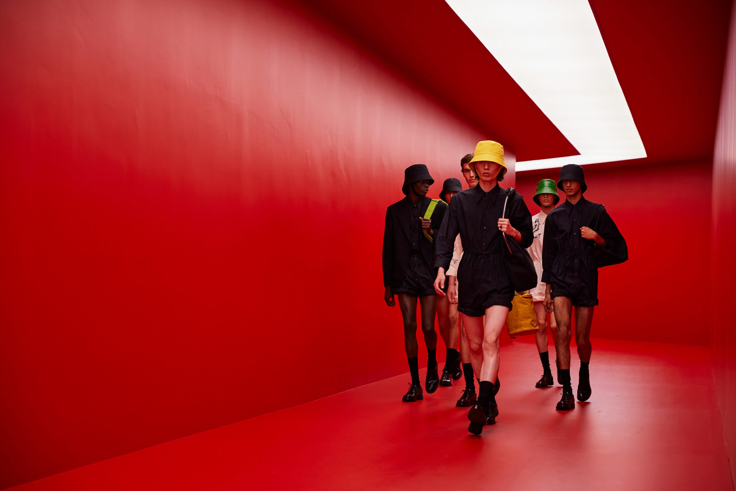 Male models walking on the AMO red runway