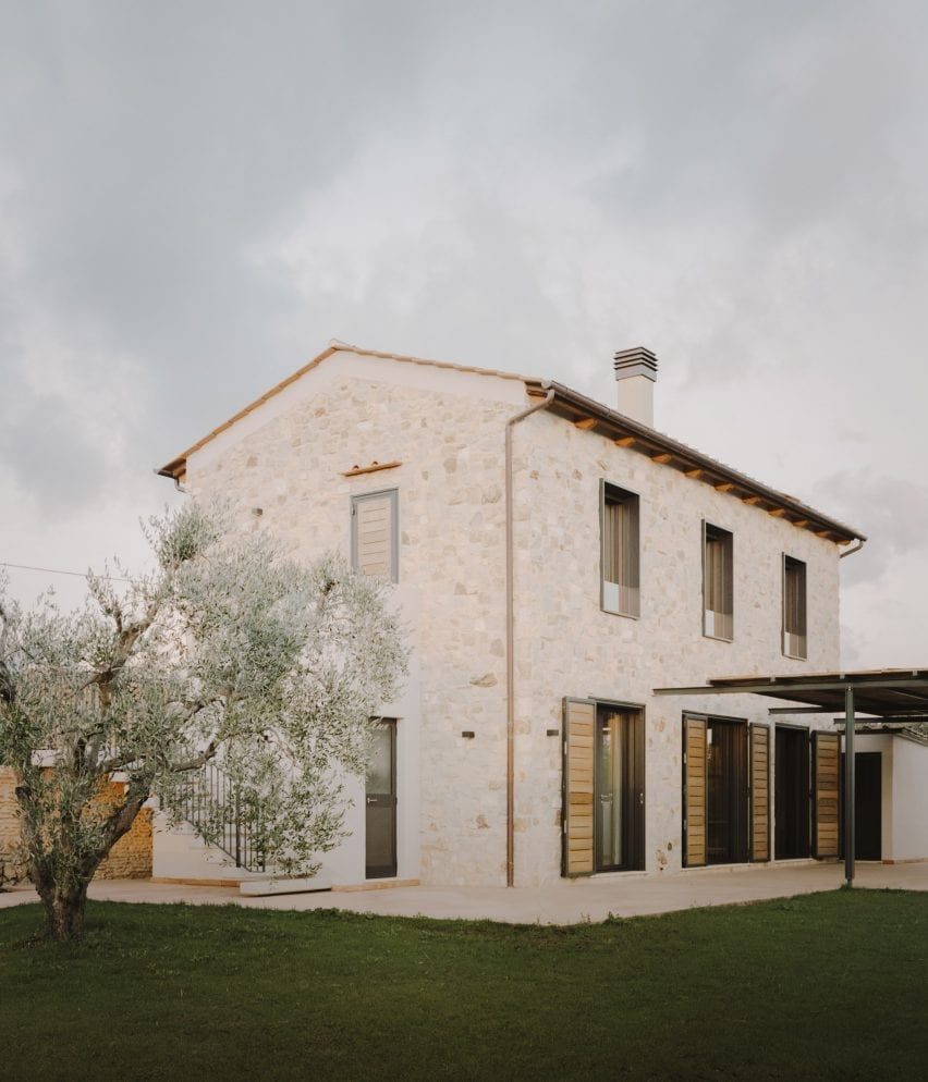 Windows line the ground and first floor of the Casamanda residence