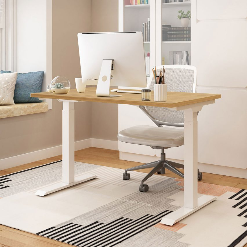 Theodore standing desk with white legs in a neutral-toned home office