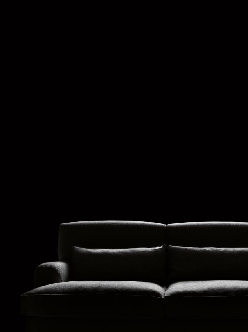 Black sofa by Boffi on a black backdrop