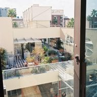 Large windows provide views across the city