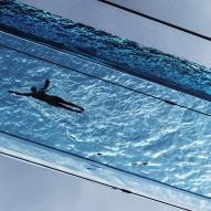 Watch a swimmer in London's fully transparent Sky Pool