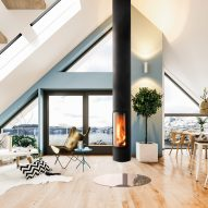 A residential interior with a central wood-burning fireplace