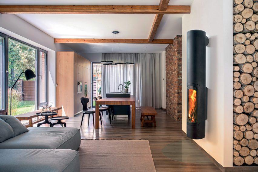 A black wall-mounted wood-burning fireplace