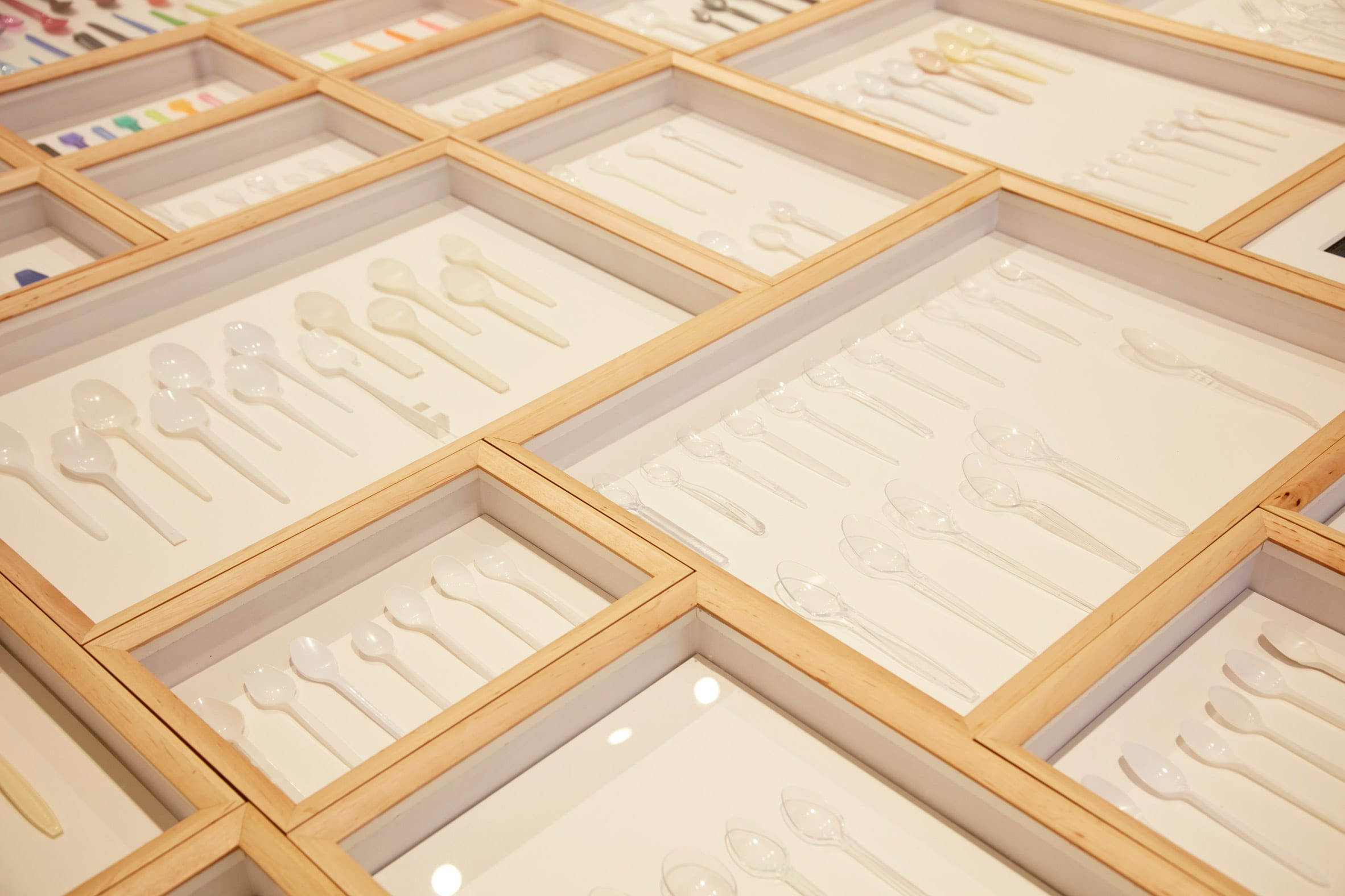 White spoons are displayed at exhibition