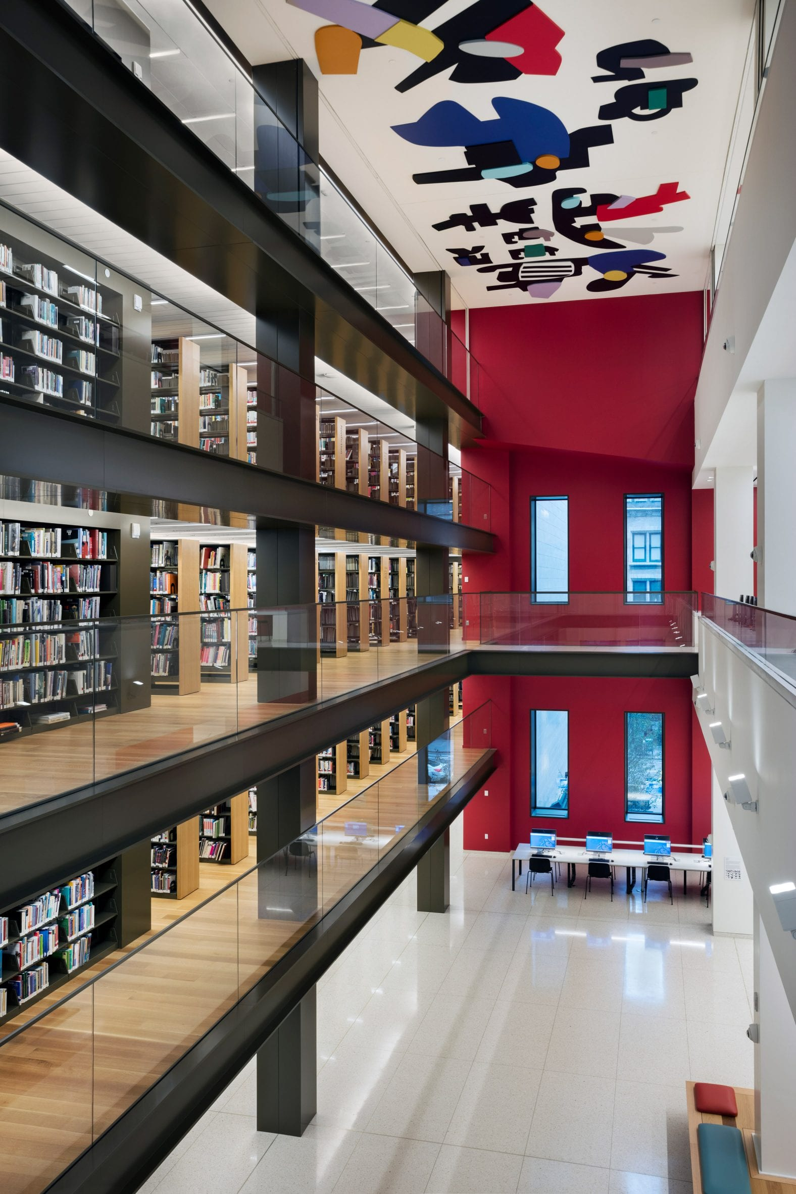 Stavros Niarchos Foundation Library atrium with bookshelves on one side