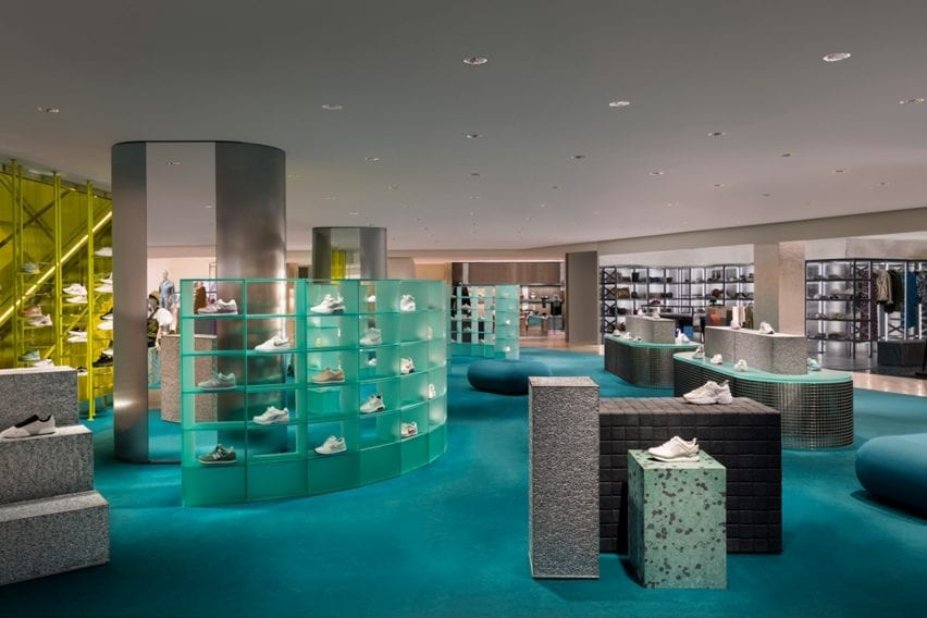 An overview of the La Rinascente women's clothing department with a blue carpet and gray displays
