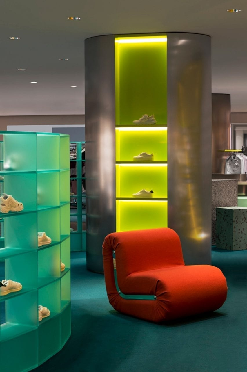 Illuminated display columns with red armchair in Rinascente womenswear department