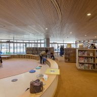 A children's library has a wood and orange interior