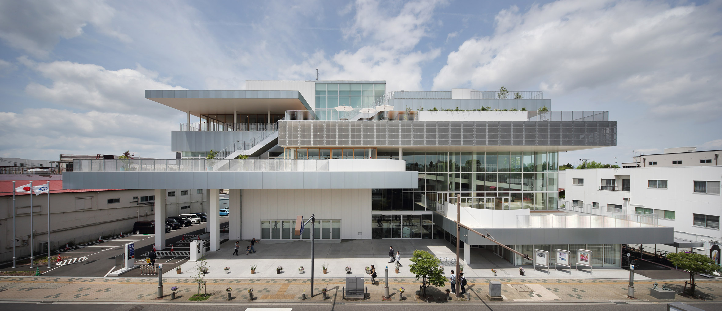 The exterior of The Sukagawa Community Center has a stacked design