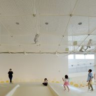A net play area covers the indoor playspace