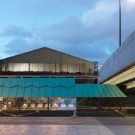 Adam Richards Architects tops floating Cheese Barge with patinated aluminium roof