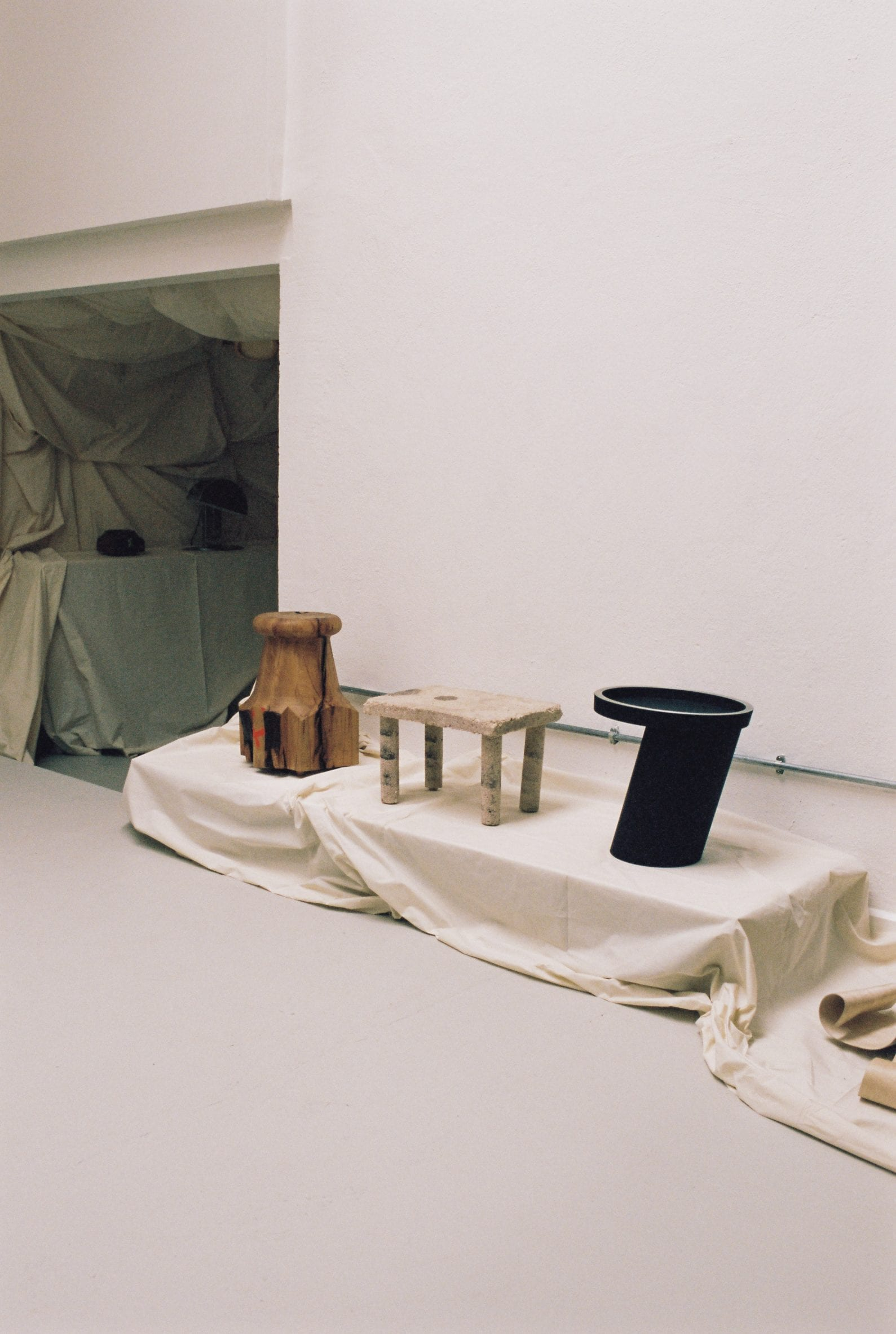Objects were places atop fabric draped plinths at The Radford Gallery