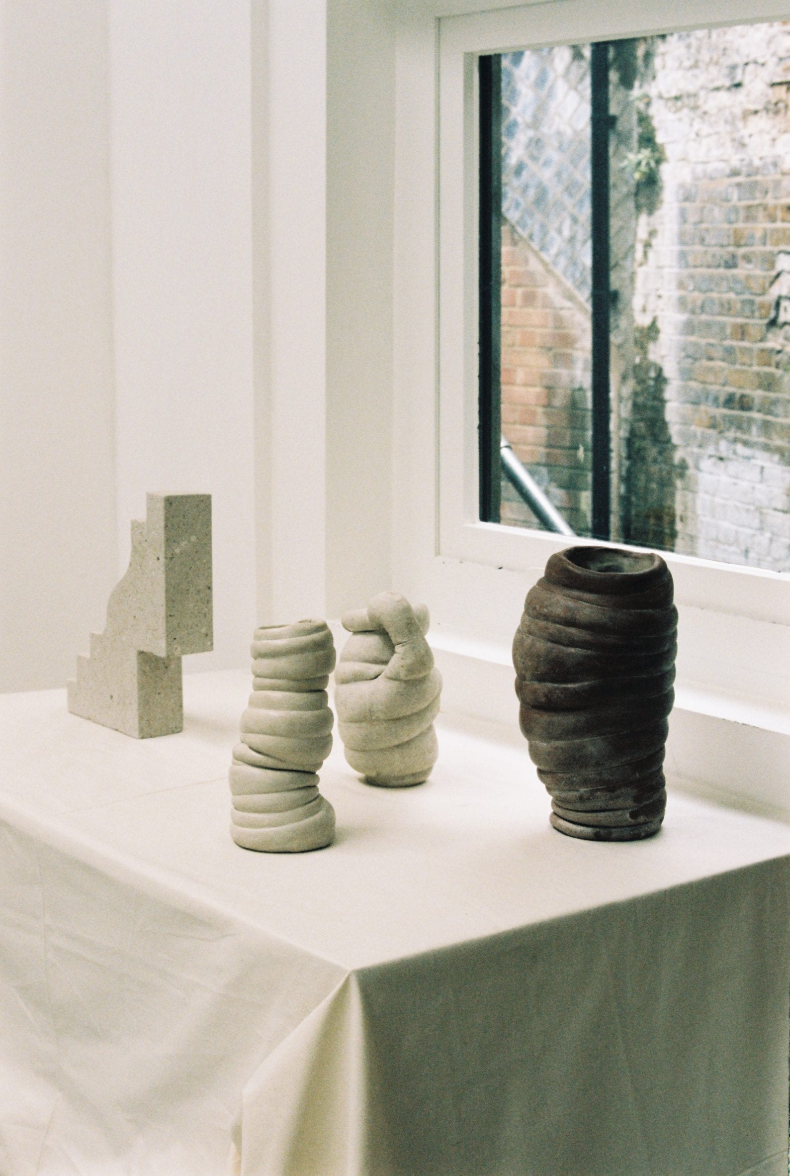 A collection of cement and stone vases and sculptures