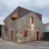Tiago Sousa inserts brick house into stone ruin in Portugal