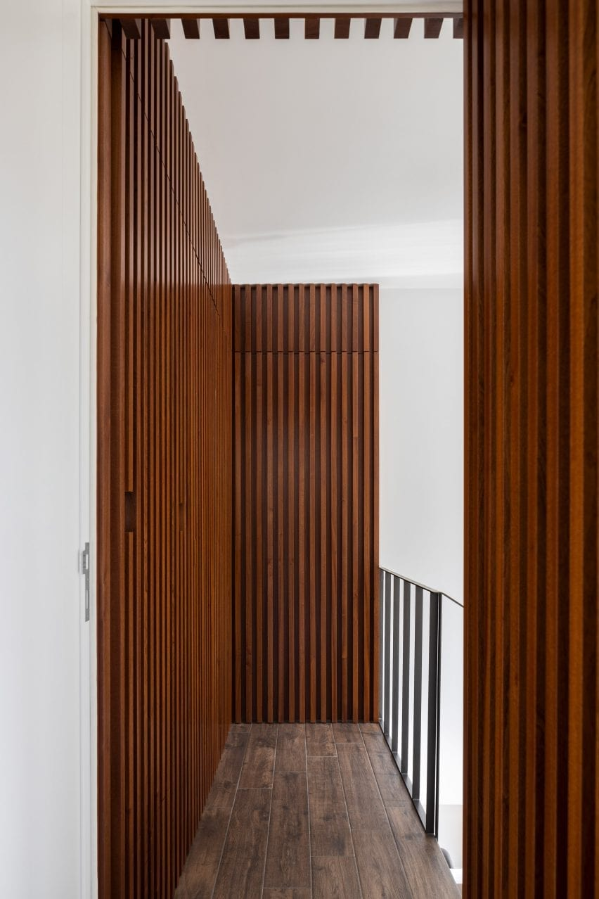 Stained wood was used throughout the home by Tiago Sousa