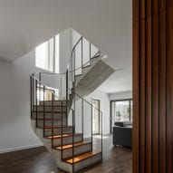 A spiral staircase links floors