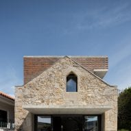 A concrete canopy extend over a glazed wall