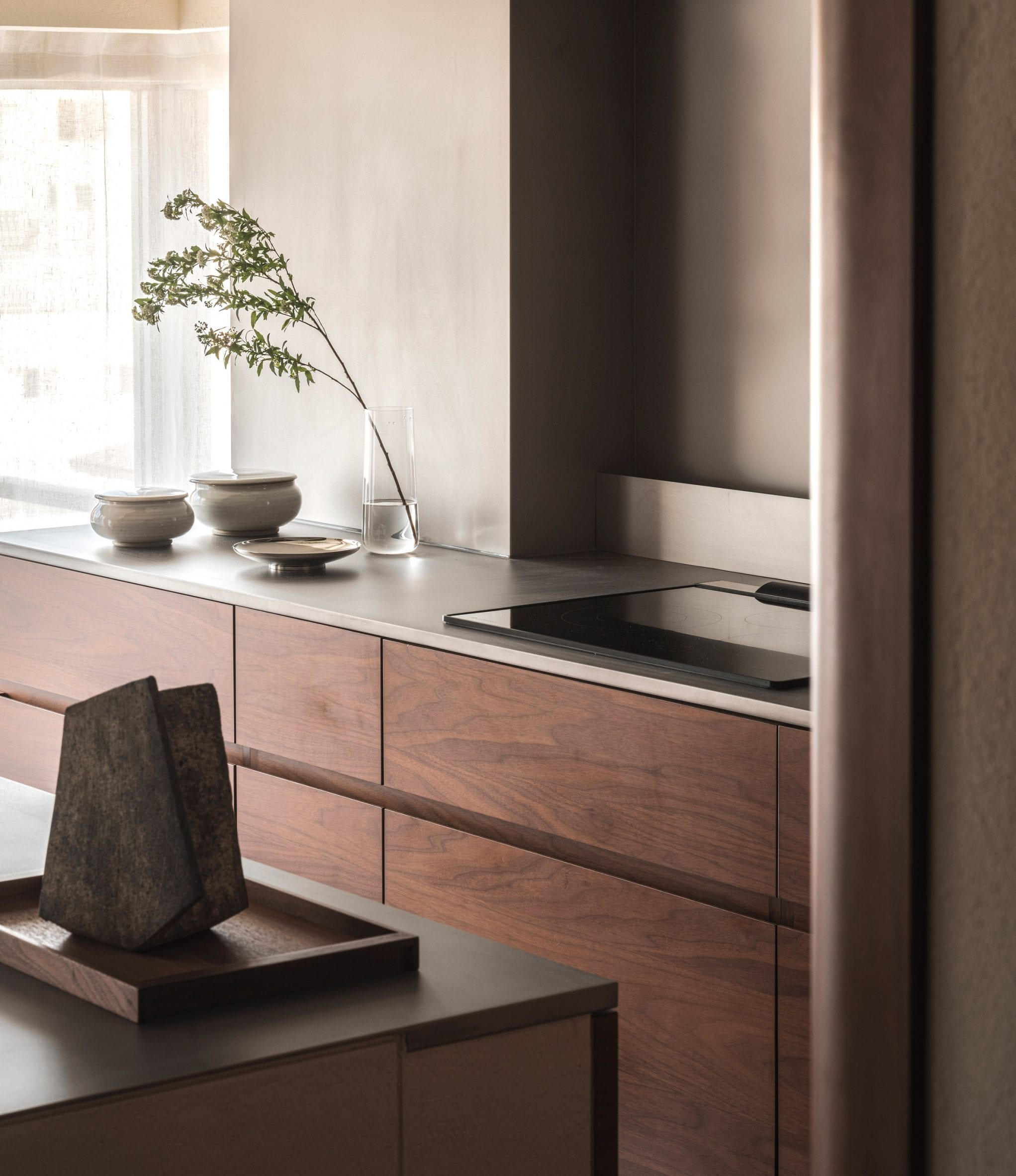 Kitchen with walnut wood shelves in Tokyo flat interior by I IN