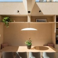 A wooden nook contains seating and storage