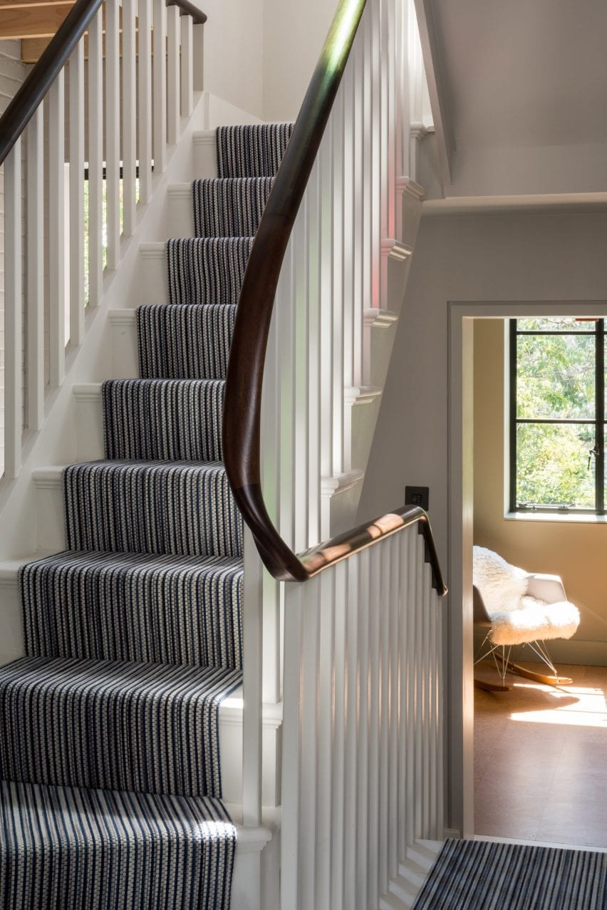 A striped runner lines the stairs