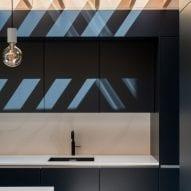 The kitchen has a dark design