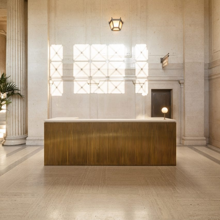 Gold-coloured counter with orb light in Victoria House office interior