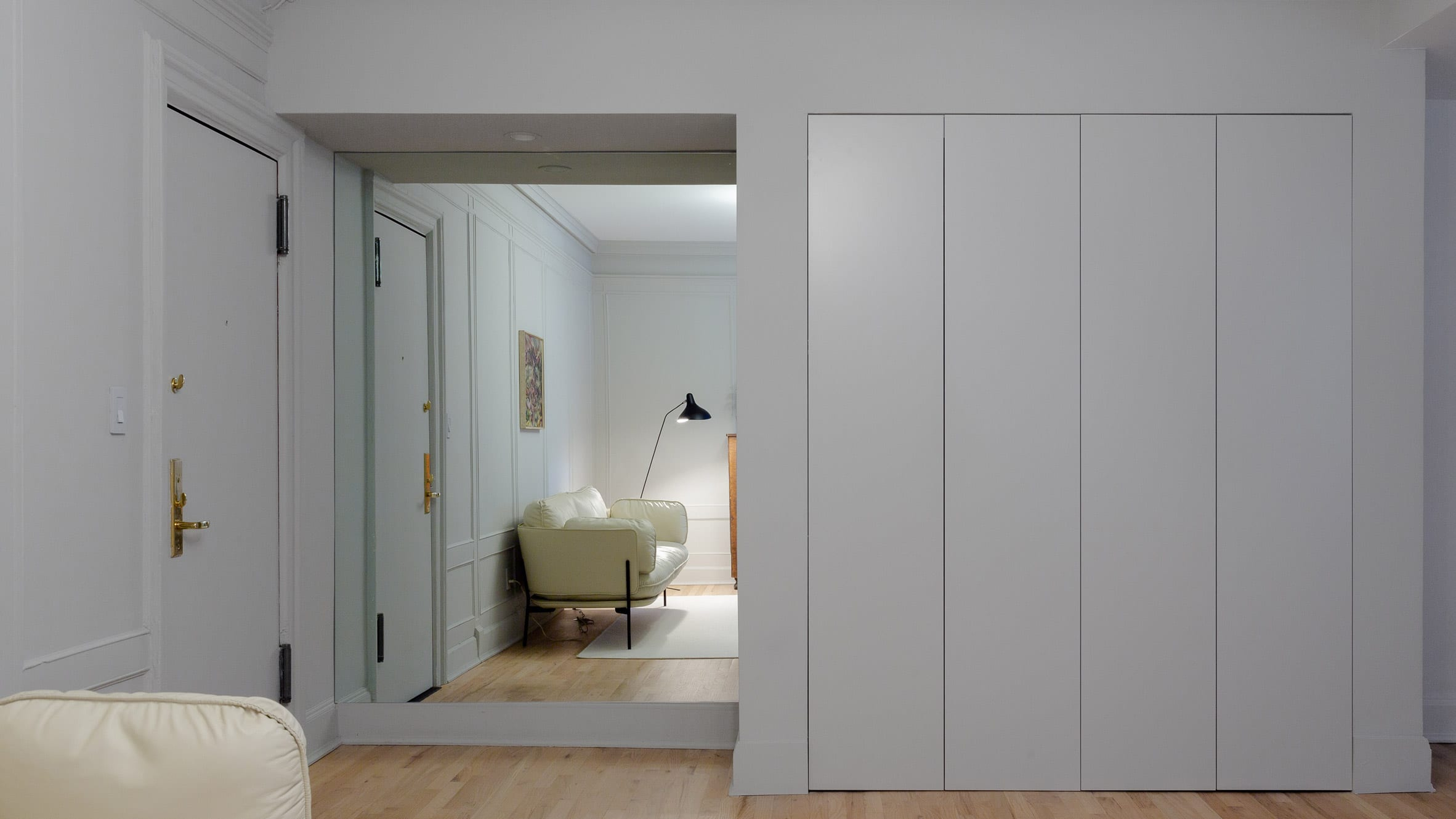 Brooklyn apartment foyer with built-in closets