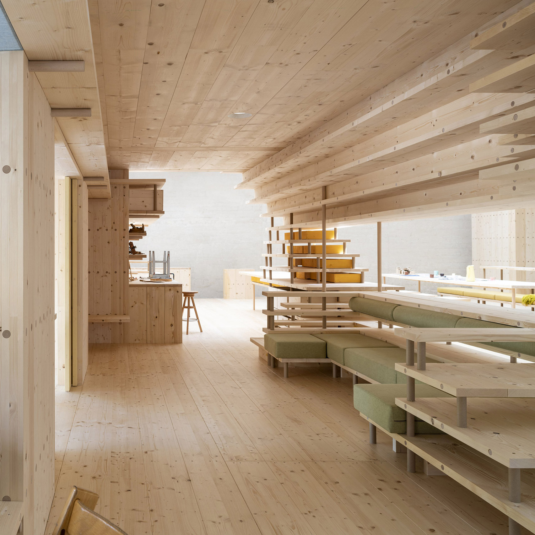 Wood lines the interior of a co-living space at the Nordic Pavilion
