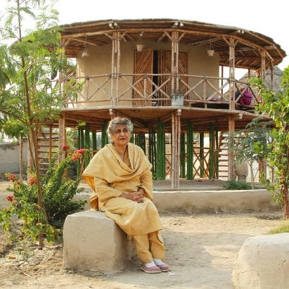 Yasmeen Lari in front of an earth and bamboo Women's Centre
