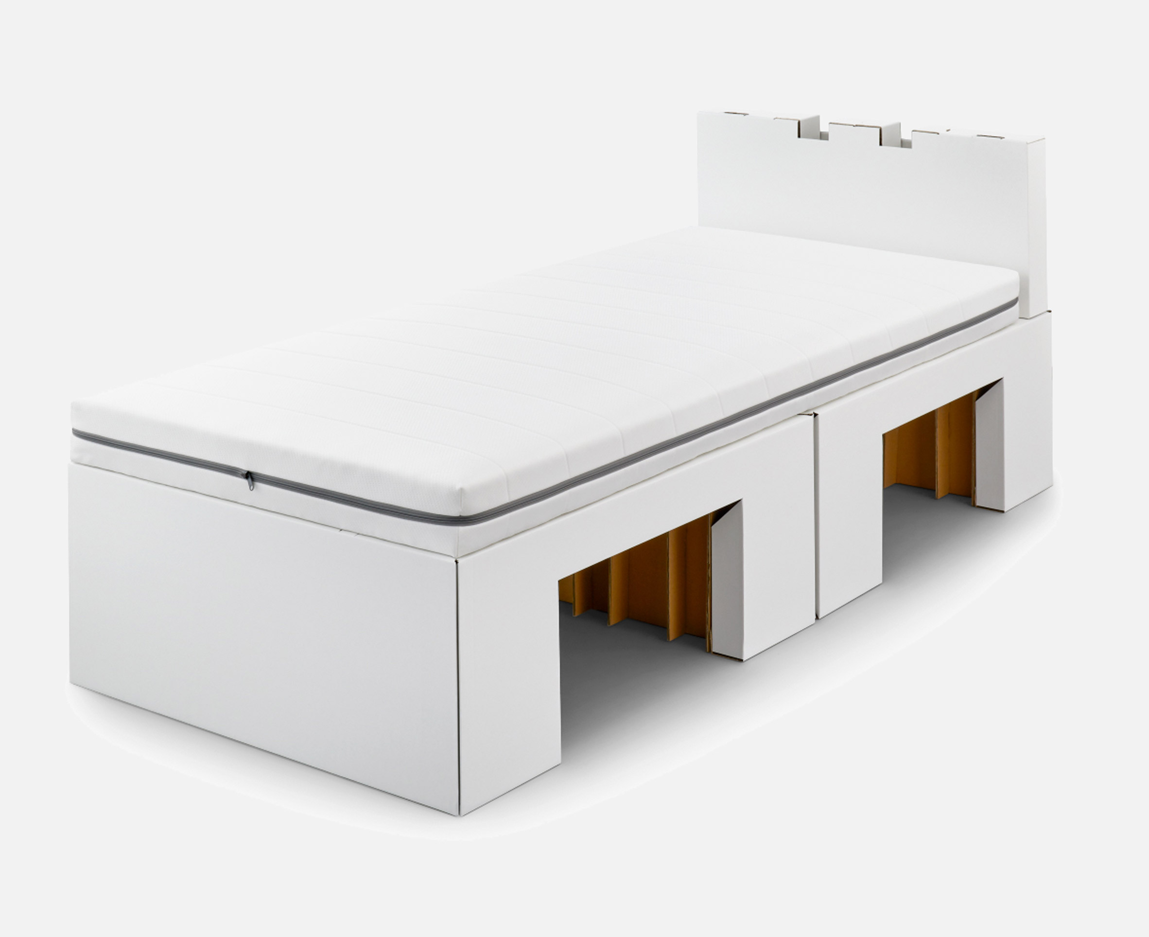 A white cardboard bed and mattress by Airweave