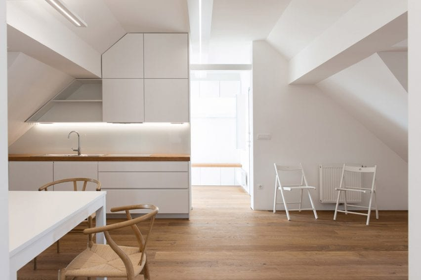 Attic apartment with white walls