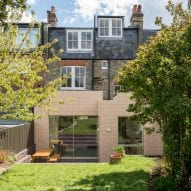Pale pink tiles create distinctive new facade for London terrace renovated by Archmongers